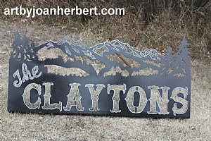 2'x 3', with black hammered metal finish and highlighted with a paint pen.  Holes pre drilled in the back for mounting ontop off a rail fence.